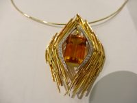 ANDREW GRIMA 18CT GOLD CITRINE AND DIAMOND PENDANT/BROOCH