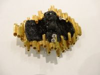 ANDREW GRIMA 18CT GOLD/BLACK STONE PENDANT/BROOCH with 3 small diamonds