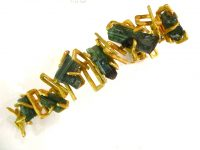 Wonderful bracelet designed by ANDREW GRIMA for Hooper Bolton with rough cut tourmaline in 18ct gold.