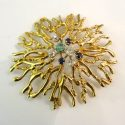 JOHN DONALD 18CT BROOCH WITH 4 DIAMONDS,SMALL SAPHIRES AND ONE EMERALD. 1970.