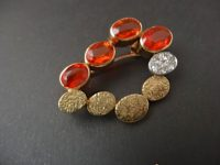 ANDREW GRIMA 18ct GOLD BROOCH/PENDANT WITH FIRE OPALS