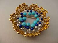 "BROOCH IN TURQUOISE AND LAPIS,WITH DIAMONDS UNSIGNED JOHN DONALD ""CROWN BROOCH"""