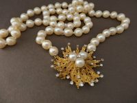 ANDREW GRIMA STRING OF PEARLS WITH GOLD AND DIAMOND ATTACHEMENT, SIGNED
